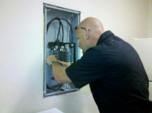 Electrician from Wendt Electric providing electrical contractor services on an electrical panel